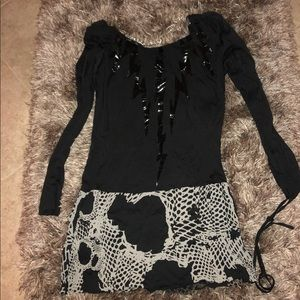 Long sleeve blouse. Could be worn as a dress.